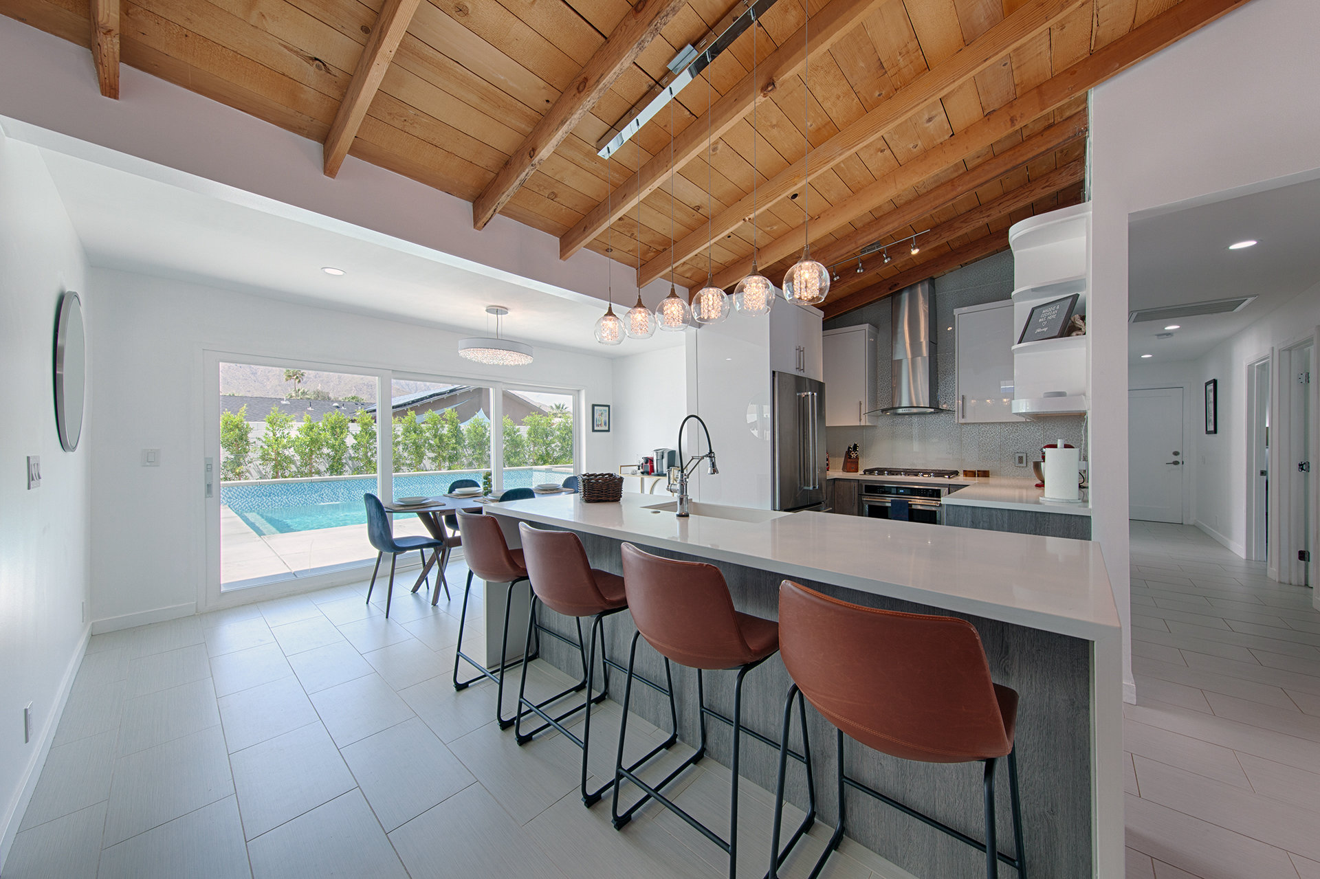 Remodled kitchen with leather stools in a home in Palm Springs, California