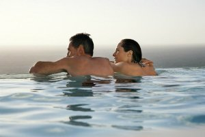 Couple Relaxes in Palm Springs Resort Pool