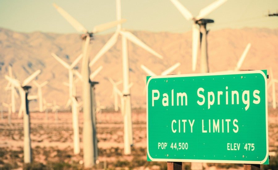 palm springs city limits sign, windmills in the background